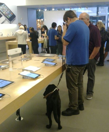 Blind Apple Store Salesman fixing a technical problem for a Space X Engineer