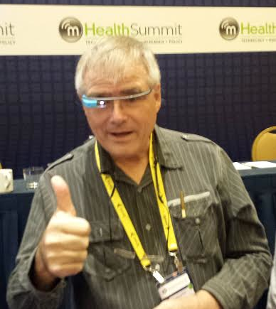 Dr Chris Bickford giving Google Glass the thumbs up #mHealth13