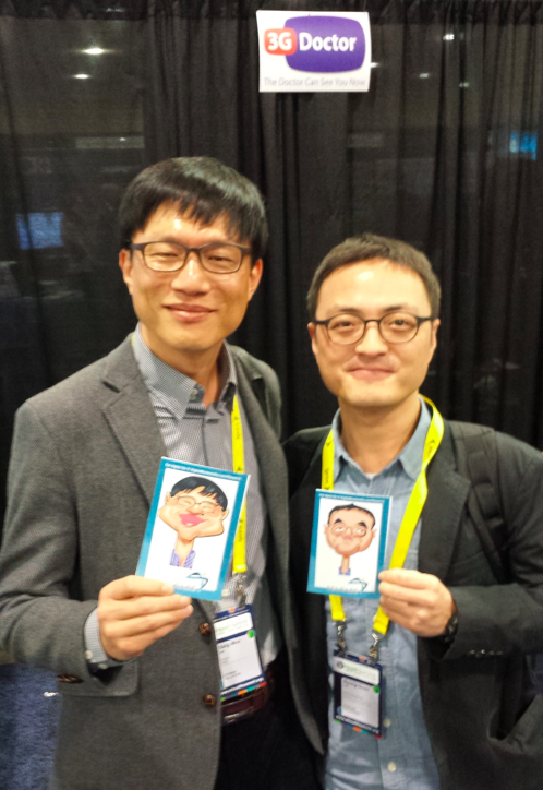 Lee Sang Won and Lee Byung Goan KHIDI show off their Telcare portraits #mHealth13