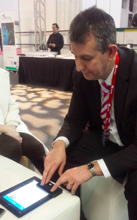 Edwin Poots Minister of Health demonstrates the Alivecor ECG