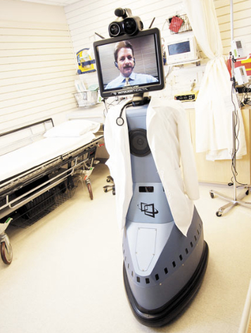 RP-7i Robot from InTouch Health a virtual Doctor dressed up to appear like a real Doctor